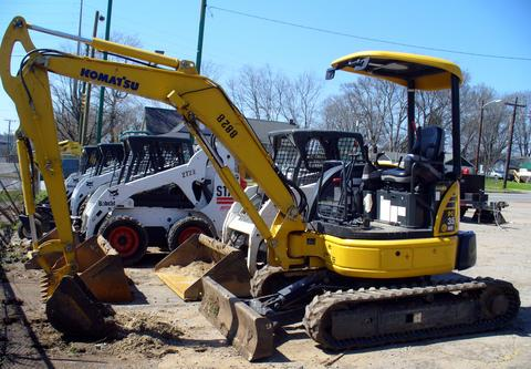 excavators at work. Komatsu Mini Excavator PC35